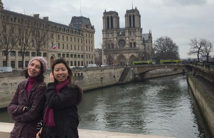 FilmDoo co-founder Weerada with a friend in front of Notre Dame in Paris